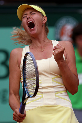 PARIS, FRANCE - MAY 26:  Maria Sharapova of Russia celebrates after winning the second set during the women's singles round two match between Maria Sharapova of Russia and Caroline Garcia of France on day five of the French Open at Roland Garros on May 26