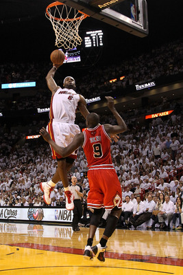 MIAMI, FL - MAY 24:  LeBron James #6 of the Miami Heat dunks on Luol Deng #9 of the Chicago Bulls  in Game Four of the Eastern Conference Finals during the 2011 NBA Playoffs on May 24, 2011 at American Airlines Arena in Miami, Florida. NOTE TO USER: User