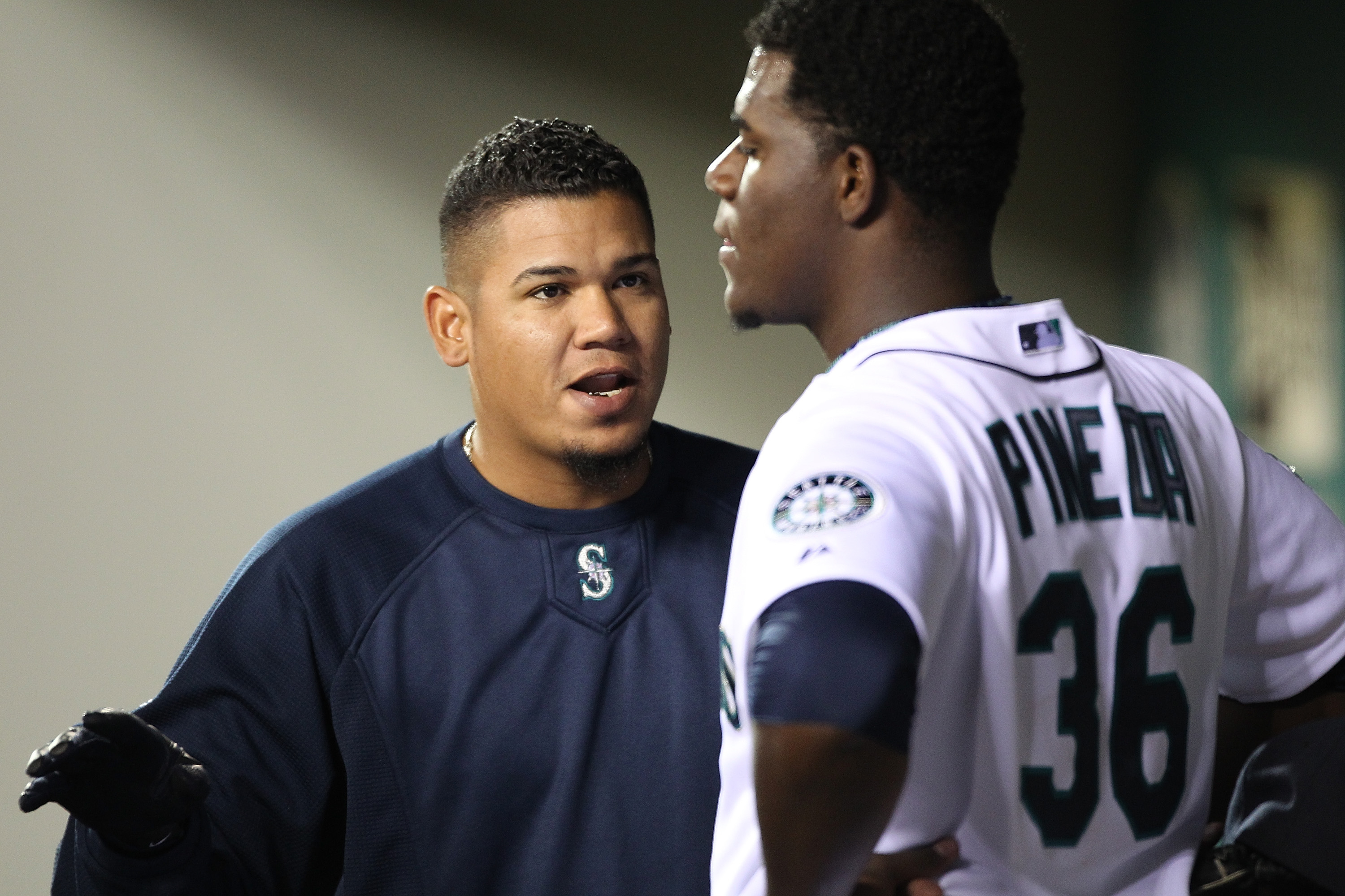 SEATTLE - APRIL 12:  Felix Hernandez #34 of the Seattle Mariners talks with starting pitcher Michael Pineda #36 after he was removed from the game in the eighth inning against the Toronto Blue Jays at Safeco Field on April 12, 2011 in Seattle, Washington.