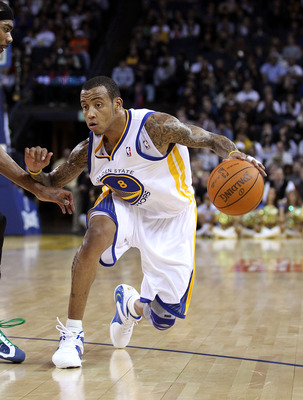 OAKLAND, CA - DECEMBER 14:  Monta Ellis #8 of the Golden State Warriors in action against the Minnesota Timberwolves at Oracle Arena on December 14, 2010 in Oakland, California.  NOTE TO USER: User expressly acknowledges and agrees that, by downloading an