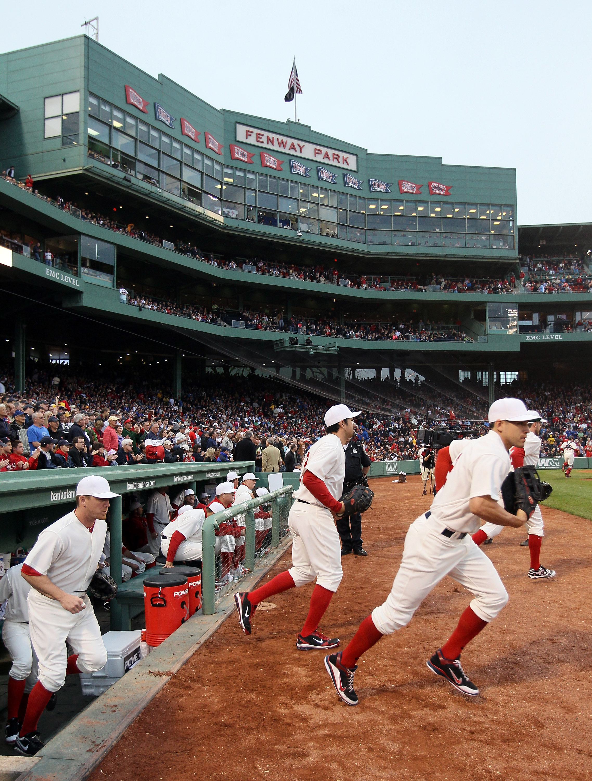 BOSTON, MA - MAY 21:  The Boston Red Sox take the field for the game against the Chicago Cubs on May 21, 2011 at Fenway Park in Boston, Massachusetts. Tonight the Chicago Cubs and the Boston Red Sox are wearing replica uniforms from 1918. Before this seri
