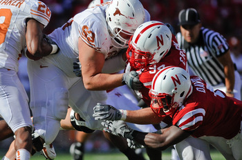 LINCOLN, NE - OCTOBER 16: Linebacker Lavonte David #4 and defensive tackle Jared Crick #94 of the Nebraska Cornhuskers attempt to get their hands on running back Foswhitt Whittaker #28 of the Texas Longhorns during first half action of their game at Memor