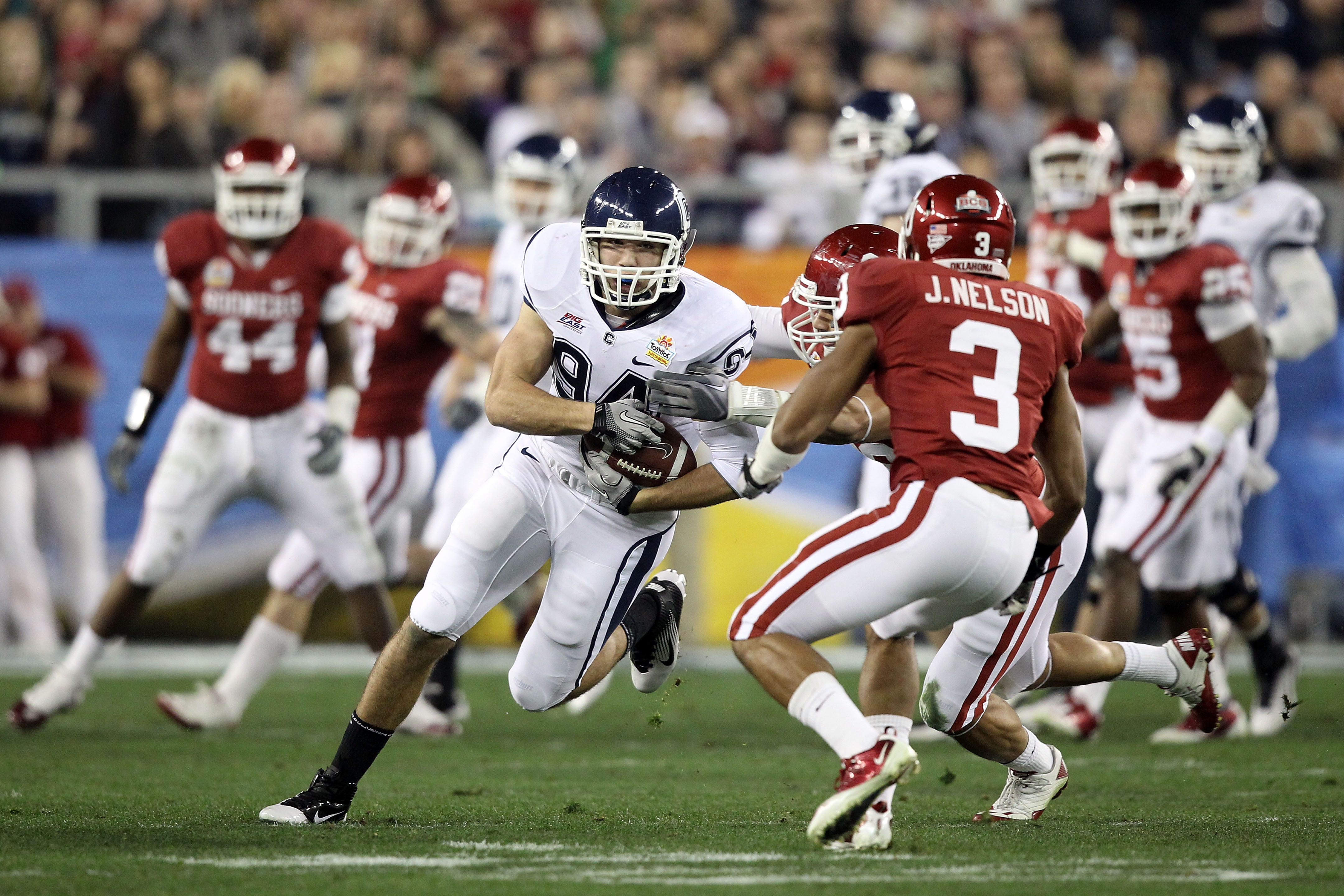 GLENDALE, AZ - JANUARY 01:  Ryan Griffin #94 of the Connecticut Huskies runs after a catch in the first half while taking on the Oklahoma Sooners during the Tostitos Fiesta Bowl at the Universtity of Phoenix Stadium on January 1, 2011 in Glendale, Arizona
