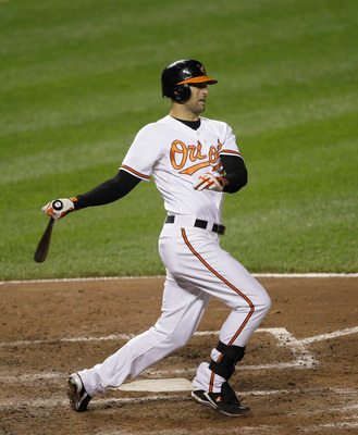 BALTIMORE, MD - MAY 25:  Nick Markakis #21 of the Baltimore Orioles at the plate against the Kansas City Royals at Oriole Park at Camden Yards on May 25, 2011 in Baltimore, Maryland.  (Photo by Rob Carr/Getty Images)
