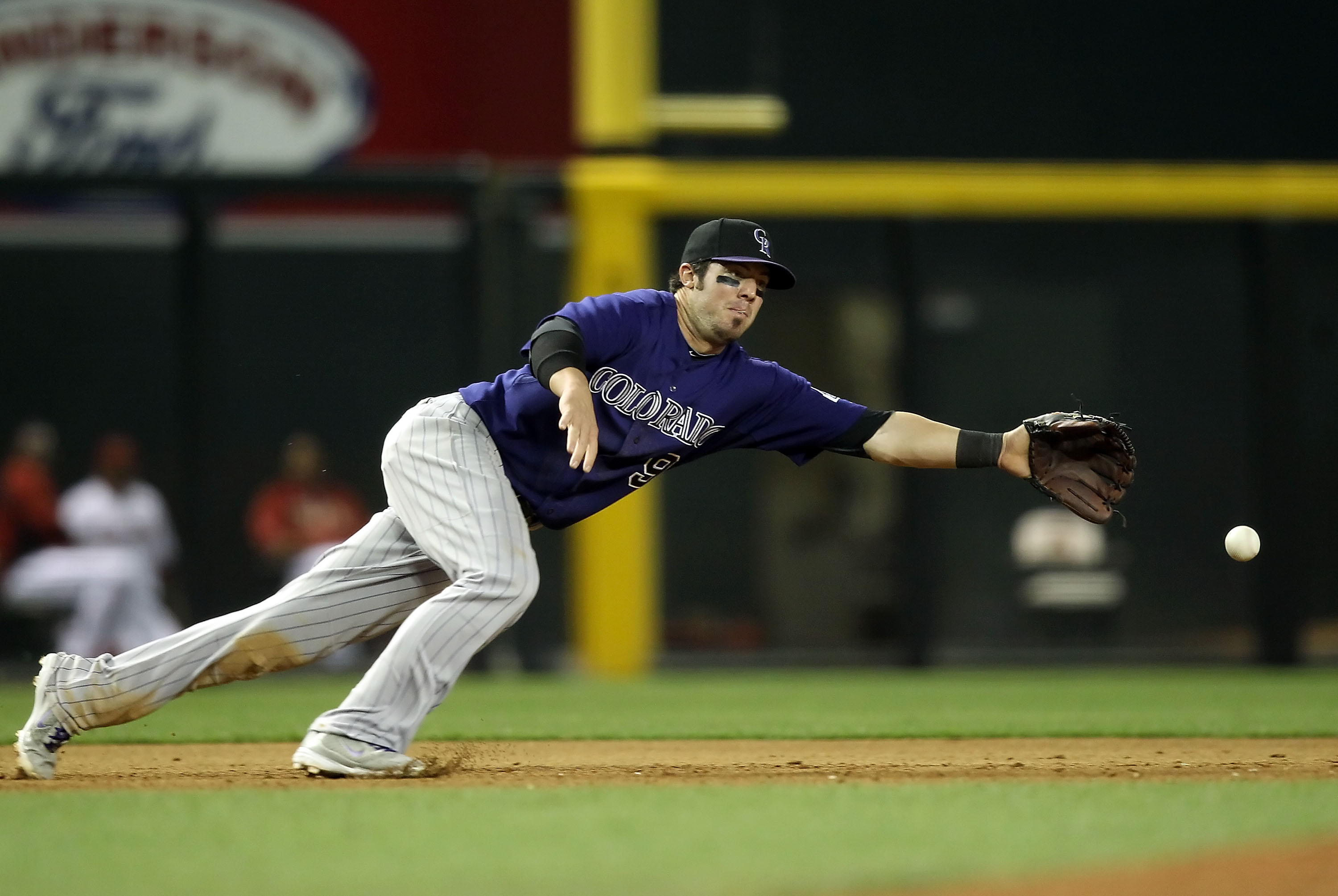 PHOENIX, AZ - MAY 05:  Infielder Ian Stewart #9 of the Colorado Rockies makes a diving attempt at a single hit by the Arizona Diamondbacks during the Major League Baseball game at Chase Field on May 5, 2011 in Phoenix, Arizona.  (Photo by Christian Peters