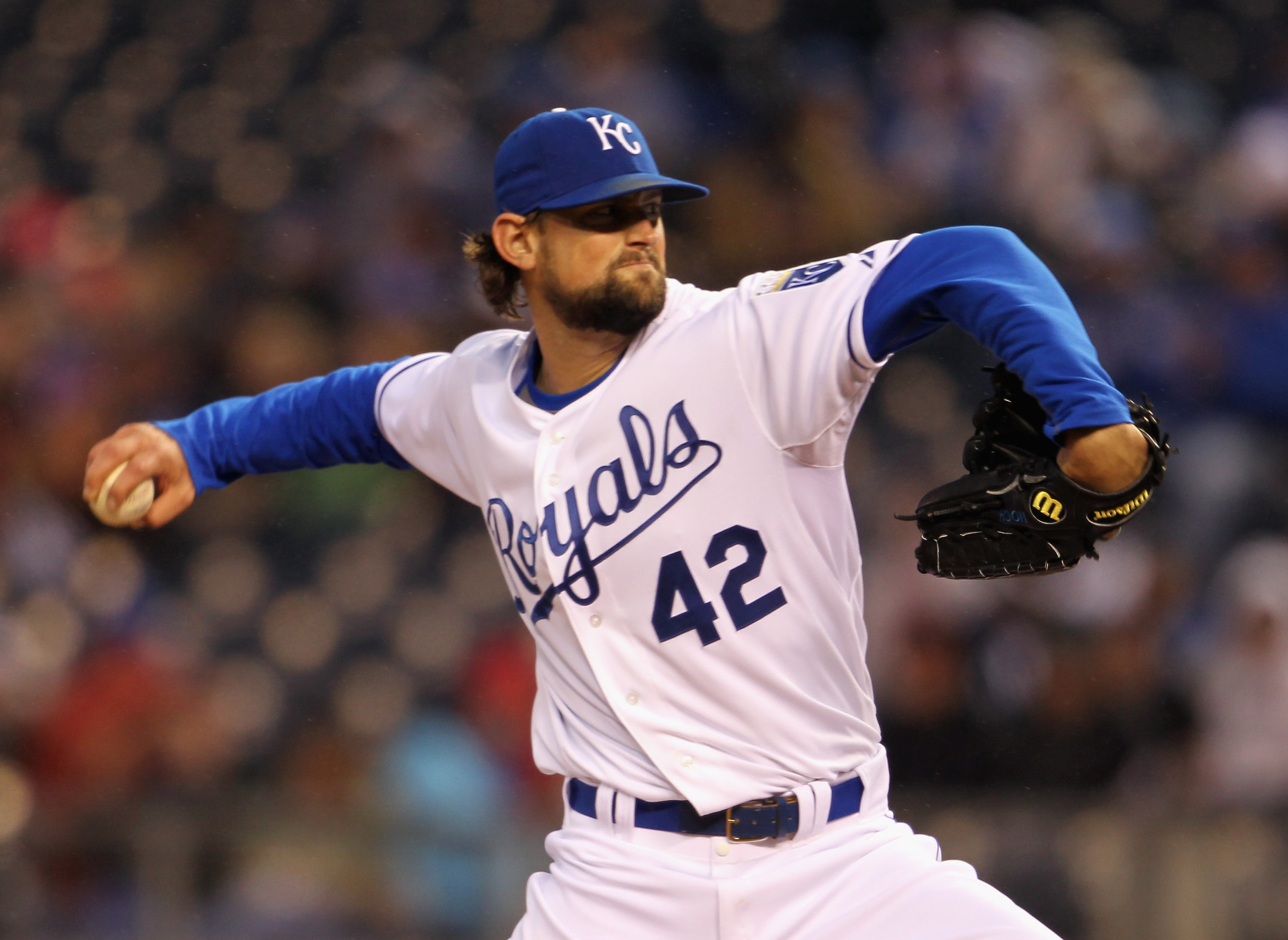 KANSAS CITY, MO - APRIL 15:  Starting pitcher Luke Hochevar #42 of the Kansas City Royals in action during the game against the Seattle Mariners at Kauffman Stadium on April 15, 2011 in Kansas City, Missouri.  (Photo by Jamie Squire/Getty Images)