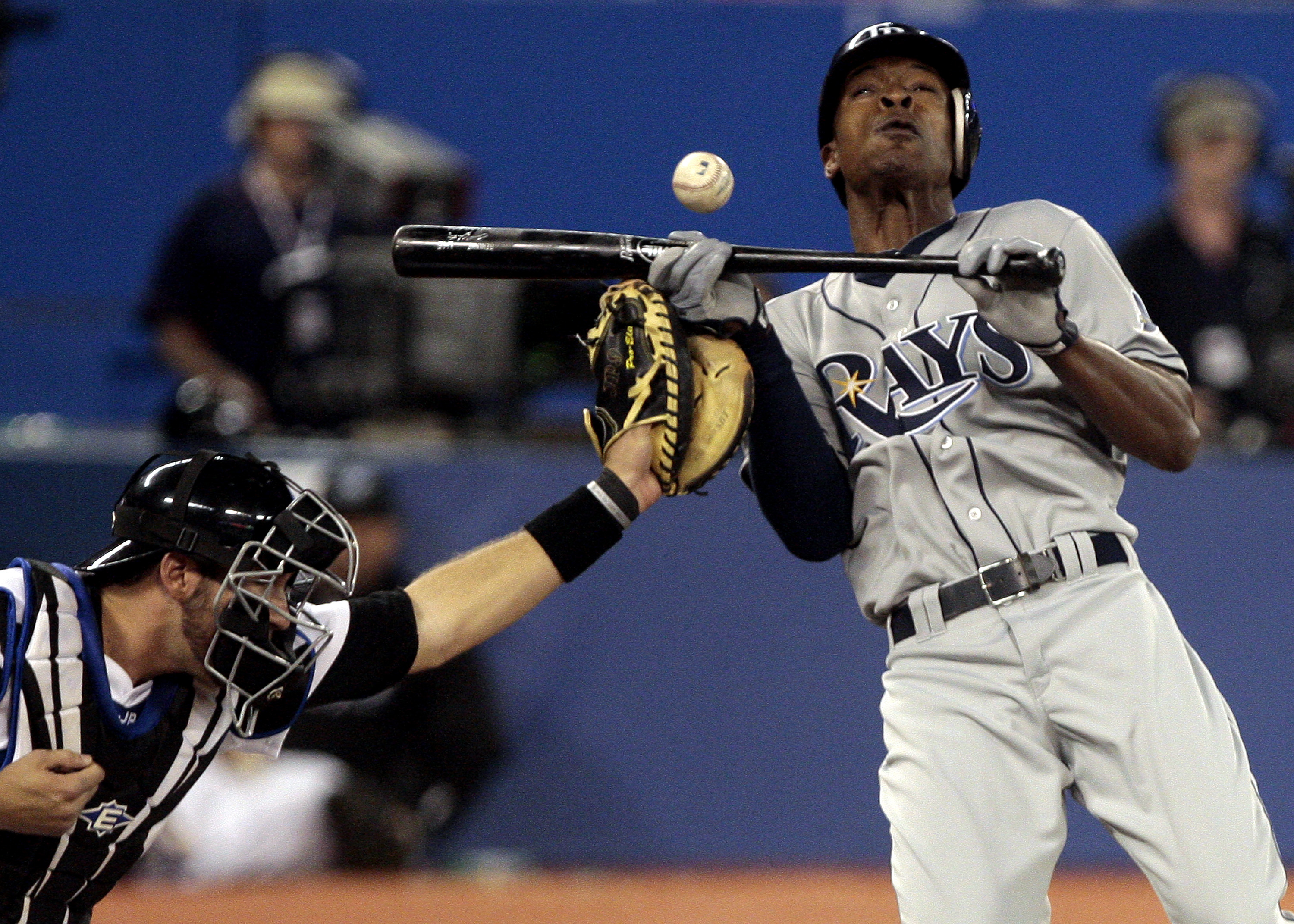 TORONTO, CANADA - MAY 18: B.J. Upton #2 of the Tampa Bay Rays gets hit by a Jesse Litsch pitch in front of J.P. Arencibia #9 of the Toronto Blue Jays during MLB action at the Rogers Centre May 18, 2011 in Toronto, Ontario, Canada. (Photo by Abelimages/Get