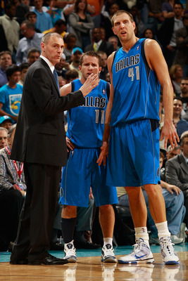 NEW ORLEANS - NOVEMBER 17:  Head coach Rick Carlisle talks with Jose Barea #11 and Dirk Nowitzki #41 of the Dallas Mavericks during a timeout against the New Orleans Hornets at the New Orleans Arena on November 17, 2010 in New Orleans, Louisiana.  The Hor