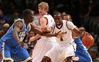 NEW YORK - NOVEMBER 21: Kevin Dillard #1 of the Southern Illinois Salukis dribbles against Jrue Holiday #21 of the UCLA Bruins on November 21, 2008 at Madison Square Garden in New York City.  (Photo by Nick Laham/Getty Images)