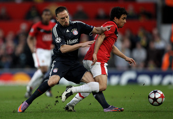 MANCHESTER, ENGLAND - APRIL 07:   Franck Ribery of Bayern Muenchen battles for the ball with Rafael of Manchester United during the UEFA Champions League Quarter Final second leg match between Manchester United and Bayern Muenchen at Old Trafford on April