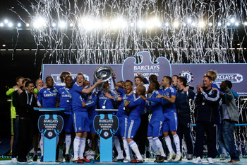 LONDON, ENGLAND - MAY 16:  Chelsea players celebrate with the trophy after winning the Barclays Premier Reserve League Play-Off Final against Blackburn Rovers at Stamford Bridge on May 16, 2011 in London, England.  (Photo by Dan Istitene/Getty Images)