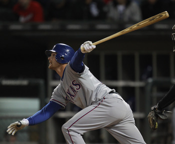 CHICAGO, IL - MAY 16: Craig Gentry #23 of the Texas Rangers hits the ball against the Chicago White Sox at U.S. Cellular Field on May 16, 2011 in Chicago, Illinois. The Rangers defeated the White Sox 4-0. (Photo by Jonathan Daniel/Getty Images)