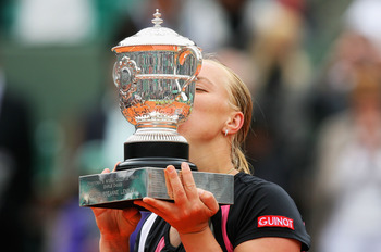 PARIS - JUNE 06:  Svetlana Kuznetsova of Russia kisses the trophy following her victory with the trophy during the Women's Singles Final match against Dinara Safina of Russia on day fourteen of the French Open at Roland Garros on June 6, 2009 in Paris, Fr