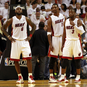 MIAMI, FL - APRIL 16:  Forward Chris Bosh #1 of the  Miami Heat with teammates Dwyane Wade #3 and LeBron James #6 against the Philadelphia 76ers at the American Airlines Arena in Game One of the Eastern Conference Quarterfinals in the 2011 NBA Playoffs on