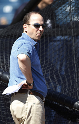 TAMPA, FL - FEBRUARY 21:  Brian Cashman Senior Vice President and General Manager of the New York Yankees watches the action during the first full team workout of Spring Training on February 20, 2011 at the George M. Steinbrenner Field in Tampa, Florida.