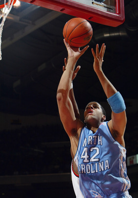 COLLEGE PARK, MD - JANUARY 14:  Sean May #42 of the North Carolina Tar Heels shoots a layup during the game against the Maryland Terrapins on January 14, 2004 at the Comcast Center in College Park, Maryland. Maryland defeated UNC 90-84. (Photo by Doug Pen