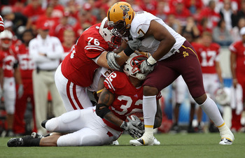 MADISON, WI - SEPTEMBER 18: John Clay #32 of the Wisconsin Badgers is tackled by the face mask by Vontaze Burfict #7 of the Arizona State Sun Devils at Camp Randall Stadium on September 18, 2010 in Madison, Wisconsin. (Photo by Jonathan Daniel/Getty Image