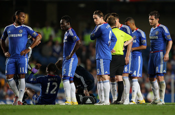 LONDON, ENGLAND - APRIL 20:  Fernando Torres of Chelsea looks on with team mates during the Barclays Premier League match between Chelsea and Birmingham City at Stamford Bridge on April 20, 2011 in London, England.  (Photo by Clive Rose/Getty Images)