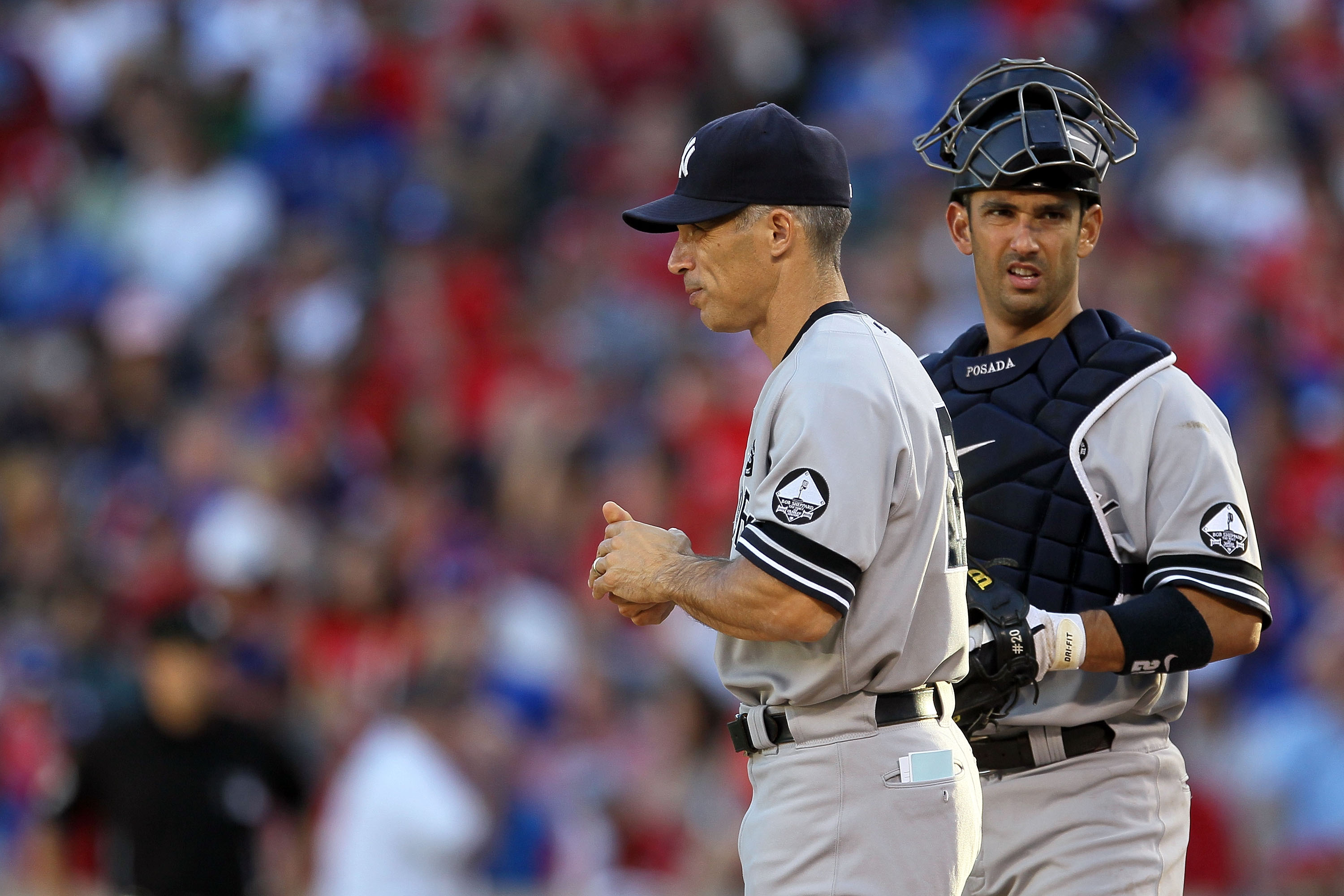 ARLINGTON, TX - OCTOBER 16:  Manager Joe Girardi and Jorge Posada #20 of the New York Yankees stand on the mound during a pitching change against the Texas Rangers in Game Two of the ALCS during the 2010 MLB Playoffs at Rangers Ballpark in Arlington on Oc