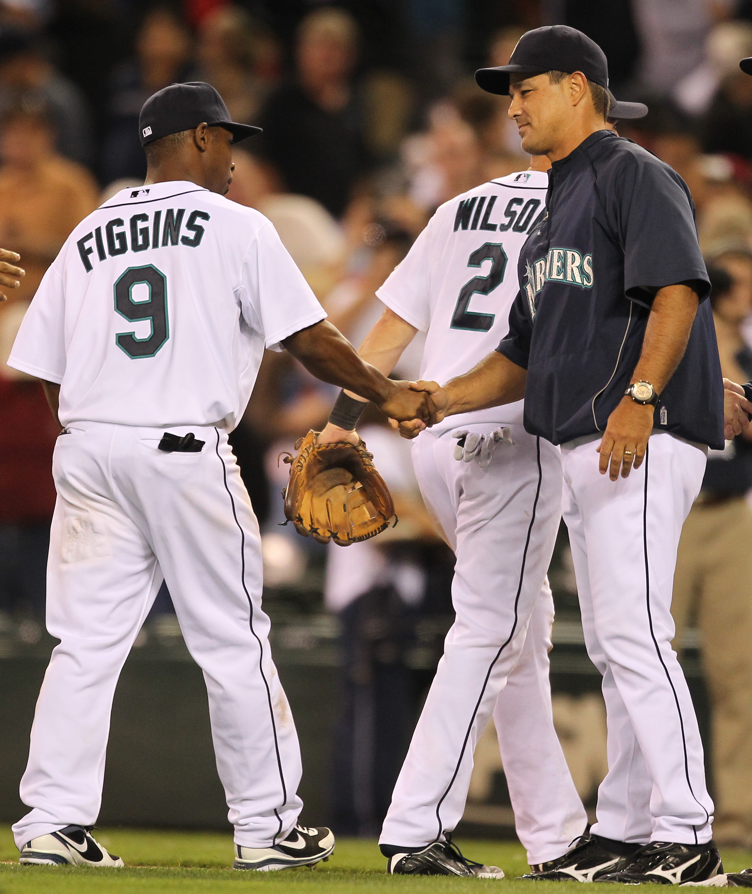 SEATTLE - AUGUST 03:  Manager Don Wakamatsu #22 of the Seattle Mariners congratulates Chone Figgins #9 after defeating the Texas Rangers 3-2 at Safeco Field on August 3, 2010 in Seattle, Washington. (Photo by Otto Greule Jr/Getty Images)