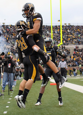 COLUMBIA, MO - NOVEMBER 13:  Wes Kemp #8  of the Missouri Tigers congratulates T.J.Moe #28 in the end zone after Moe scored a touchdown during the game against the Kansas State Wildcats on November 13, 2010 at Faurot Field/Memorial Stadium in Columbia, Mi