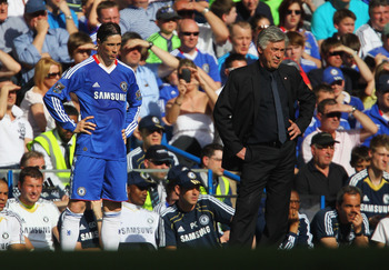 LONDON, ENGLAND - APRIL 09:  Carlo Ancelotti manager of Chelsea and substitute Fernado Torres look on from the touchline during the Barclays Premier League match between Chelsea and Wigan Athletic at Stamford Bridge on April 9, 2011 in London, England.  (