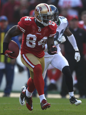 SAN FRANCISCO - DECEMBER 12:    Josh Morgan #84 of the San Francisco 49ers runs after a catch against the Seattle Seahawks during an NFL game at Candlestick Park on December 12, 2010 in San Francisco, California.  (Photo by Jed Jacobsohn/Getty Images)
