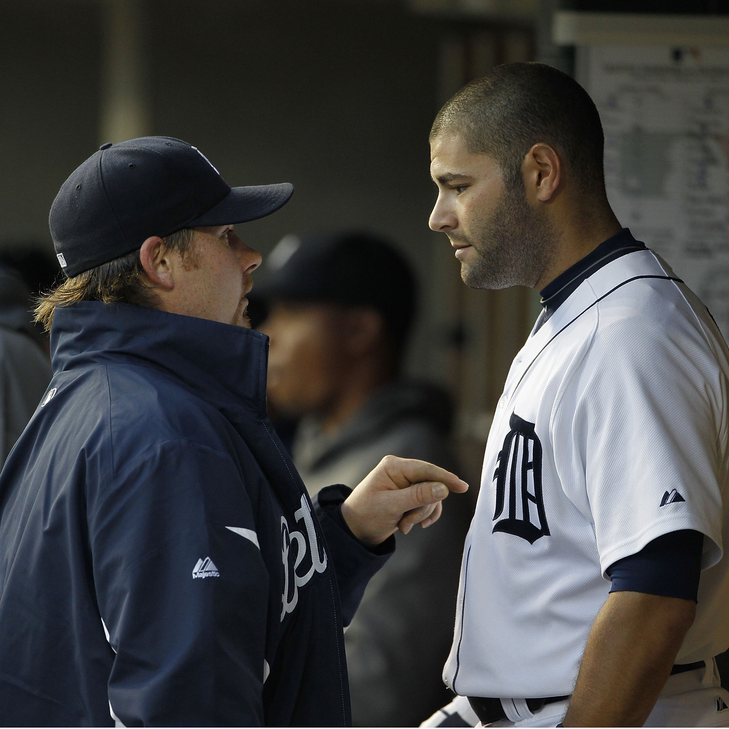 DETROIT - APRIL 26: Phil Coke #40 and Alex Avila #13 of the Detroit Tigers talk in the dugout during the game against the Seattle Mariners at Comerica Park on April 26, 2011 in Detroit, Michigan. The Mariners defeated the Tigers 7-3.  (Photo by Leon Halip