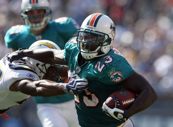 SAN DIEGO, CA - SEPTEMBER 27: Running back Ronnie Brown #23 of the Miami Dolphins runs with the ball against the San Diego Chargers at Qualcomm Stadium on September 27, 2009 in San Diego, California. (Photo by Donald Miralle/Getty Images)