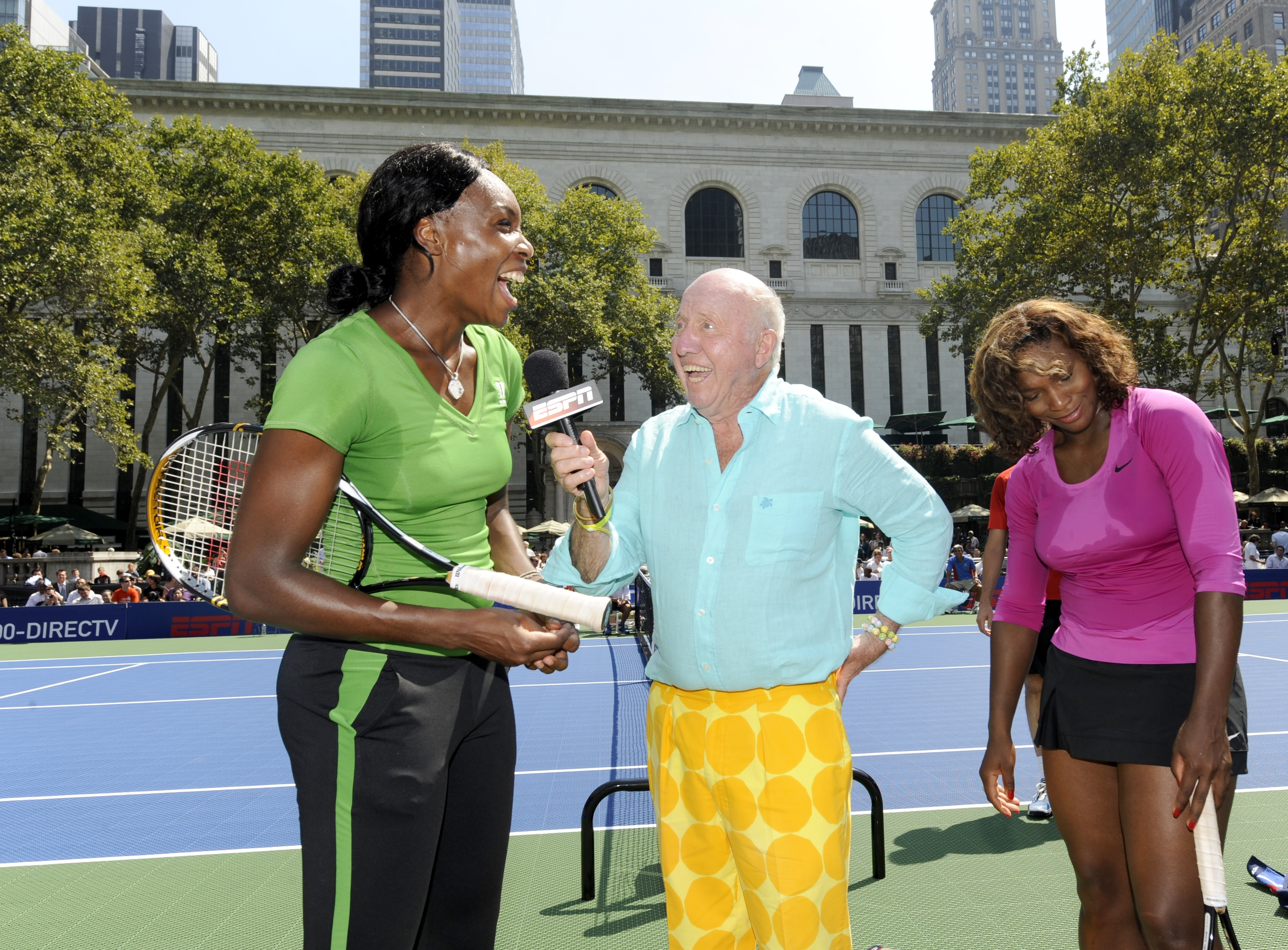 NEW YORK - AUGUST 26: Venus Williams and sister Serena Williams are interviewed by Bud Collins at the DIRECTV ESPN US Open Experience promoting DIRECTV's mosaic coverage of the US Open August 26, 2009 at Bryant Park in New York Cty. (Rob Tringali/Getty Im