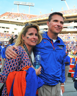 TAMPA, FL - JANUARY 1:  Coach Urban Meyer of the Florida Gators hugs his wife, Shelley, after play against the Penn State Nittany Lions January 1, 2011 in the 25th Outback Bowl at Raymond James Stadium in Tampa, Florida.  (Photo by Al Messerschmidt/Getty