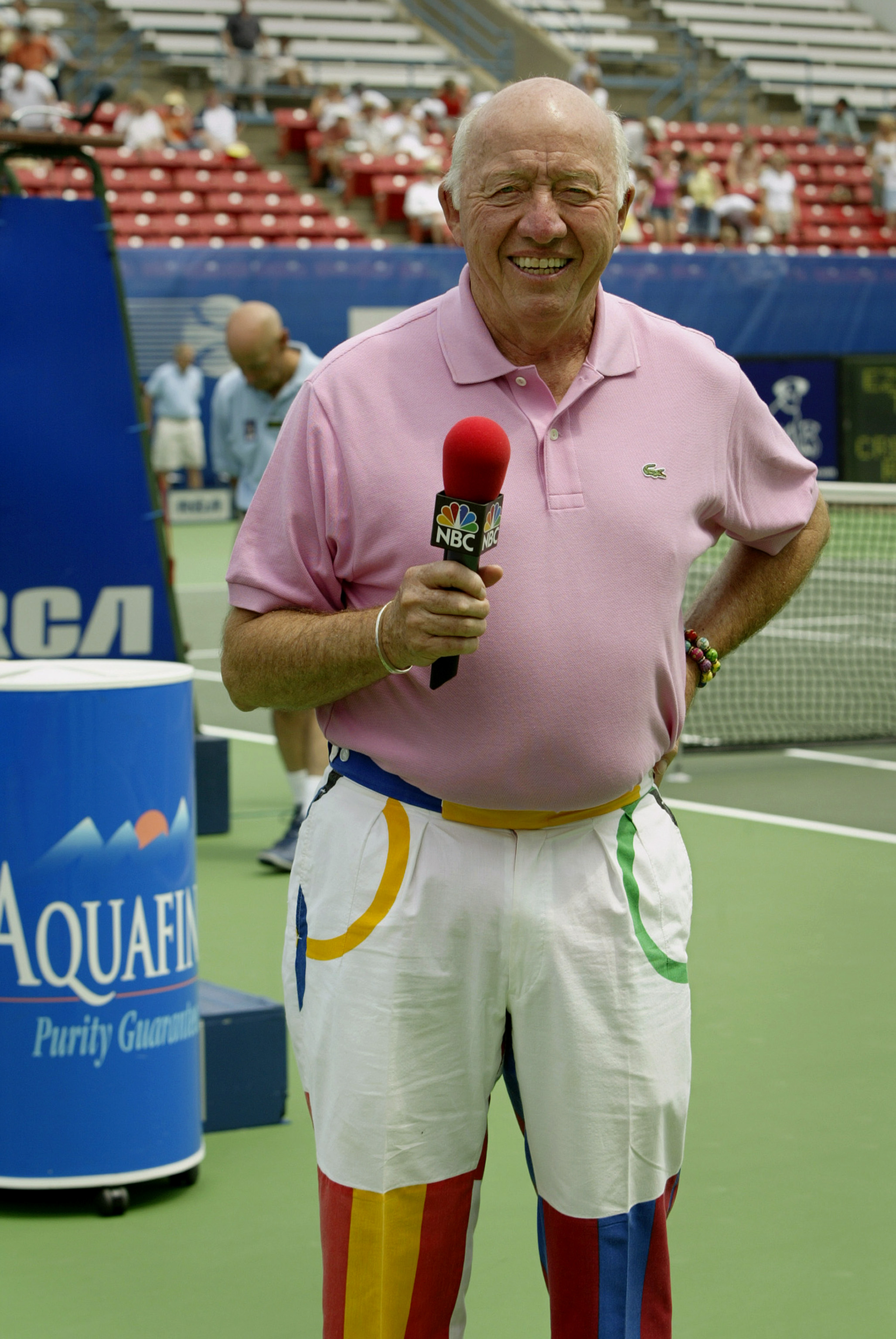 INDIANAPOLIS - JULY 26:  Bud Collins commentates for NBC as Andy Roddick of the USA takes on Sjeng Schalken of the Netherlands during the semifinals of the 2003 RCA Championships at the Indianapolis Tennis Center on July 26, 2003 in Indianapolis, Indiana.
