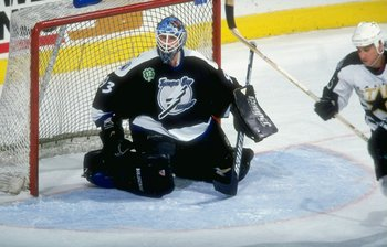 10 Dec 1997:  Goaltender Daren Puppa of the Tampa Bay Lightning in action against the Dallas Stars during a game at the Reunion Arena in Dallas, Texas.  The Stars defeated the Lightning 3-0. Mandatory Credit: Stephen Dunn  /Allsport