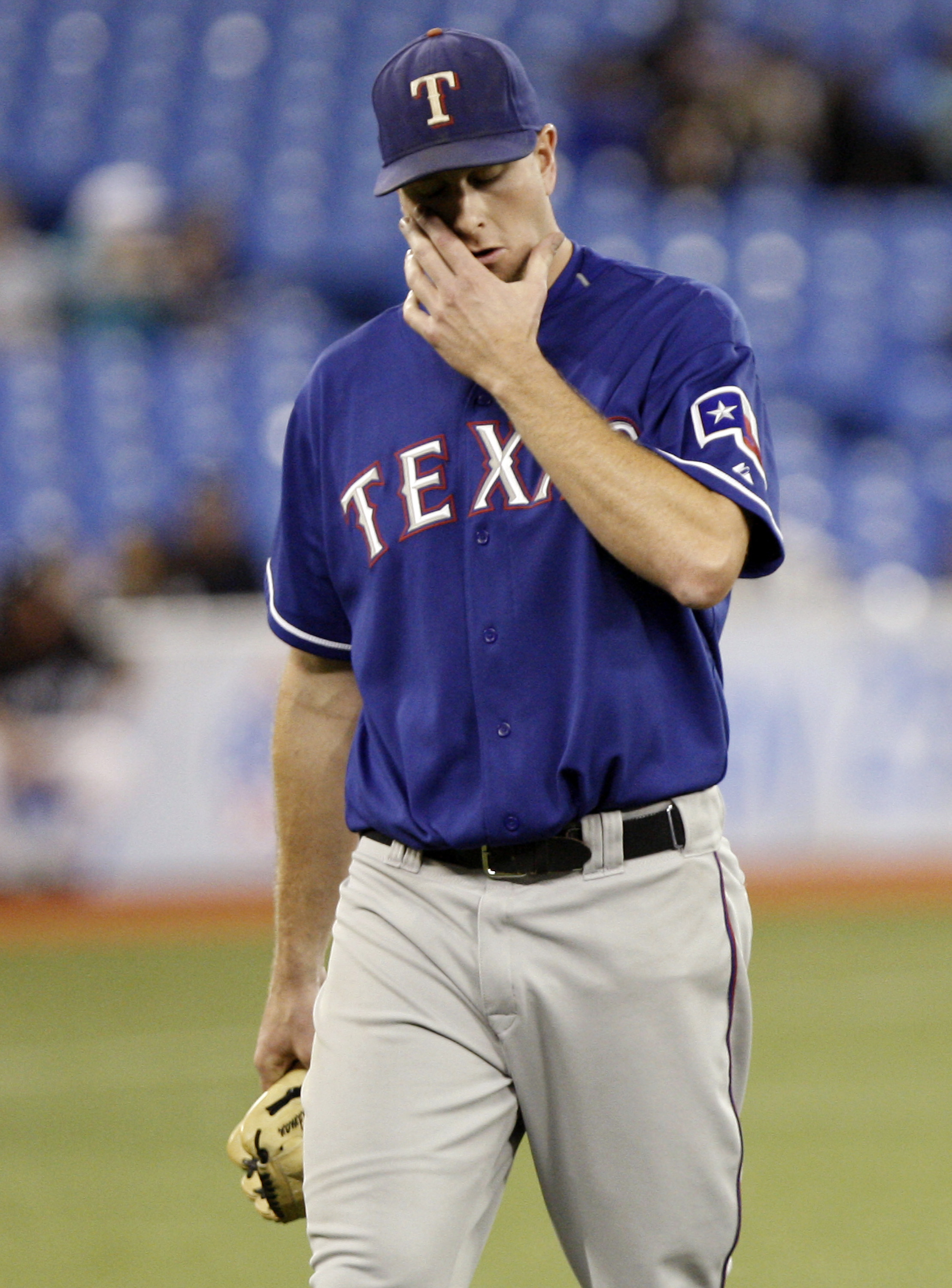 6d8c90a690f TORONTO - MAY 15  Scott Feldman  39 of the of the Texas Rangers walks.  Abelimages Getty Images. The Rangers have worn a blue alternate uniform ...