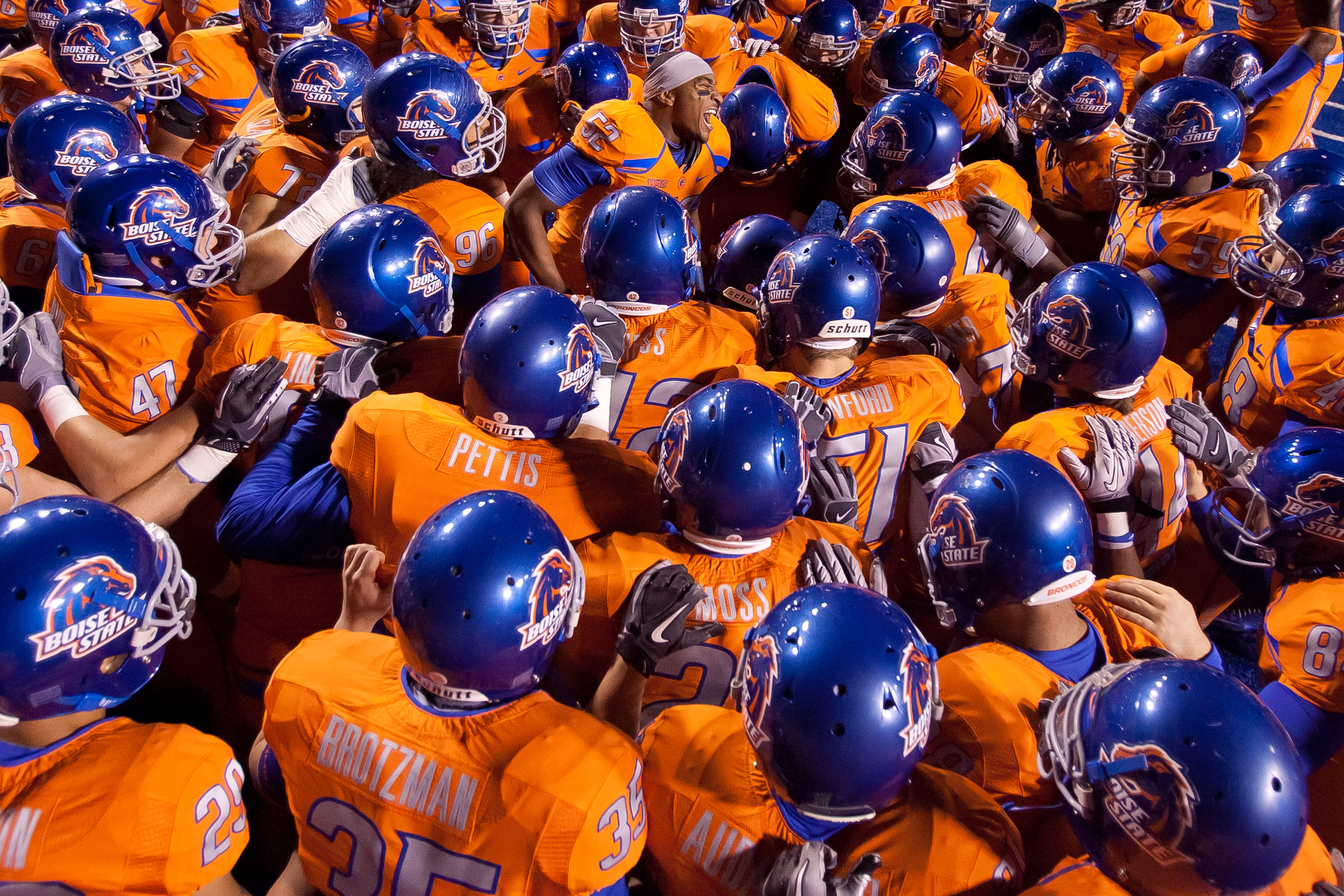 BOISE, ID - NOVEMBER 19:  Derrell Acrey #52 psyches up the Boise State Broncos before the game against the Fresno State Bulldogs at Bronco Stadium on November 19, 2010 in Boise, Idaho.  (Photo by Otto Kitsinger III/Getty Images)