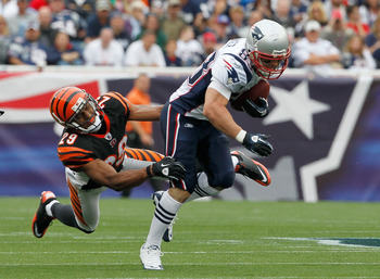 FOXBORO, MA - SEPTEMBER 12:  Wes Welker #83 of the New England Patriots gains yardage despite the defense of Leon Hall #29 of the Cincinnati Bengals during during the NFL season opener at Gillette Stadium on September 12, 2010 in Foxboro, Massachusetts. (
