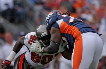 DENVER - OCTOBER 05:  Offensive tackle Ryan Clady #78 of the Denver Broncos blocks the rush of Gaines Adams #90 of the Tampa Bay Buccaneers during NFL action on October 5, 2008 in Denver, Colorado. The Broncos defeated the Buccaneers 16-13.  (Photo by Dou