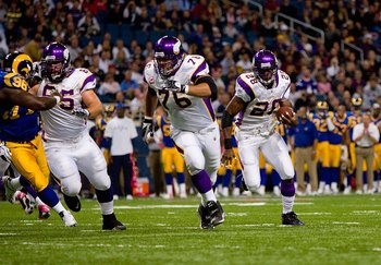 ST. LOUIS - OCTOBER 11:  Adrian Peterson #28 of the Minnesota Vikings runs to his left toward the end zone in front of teammates Steve Hutchinson #76 and John Sullivan #65 during their NFL game against the St. Louis Rams at the Edward Jones Dome on Octobe