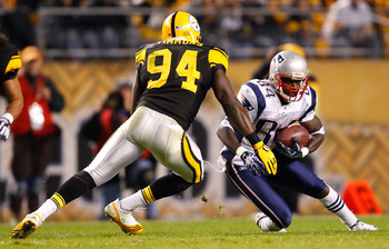 PITTSBURGH, PA - NOVEMBER 14:  Deion Branch #84 of the New England Patriots attempts to run by Lawrence Timmons #94 of the Pittsburgh Steelers during the game on November 14, 2010 at Heinz Field in Pittsburgh, Pennsylvania.  (Photo by Jared Wickerham/Gett