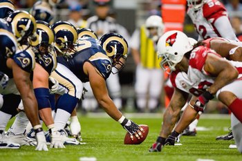 ST. LOUIS - NOVEMBER 22:  Jason Brown #60 of the St. Louis Rams gets ready to hike the ball against the Arizona Cardinals at the Edward Jones Dome on November 22, 2009 in St. Louis, Missouri. The Cardinals beat the Rams 21-13. (Photo by Dilip Vishwanat/Ge
