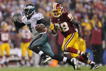 LANDOVER, MD - NOVEMBER 15:  Michael Vick #7 of the Philadelphia Eagles makes a break past Brian Orakpo #98 of the Washington Redskins on November 15, 2010 at FedExField in Landover, Maryland.  (Photo by Chris McGrath/Getty Images)