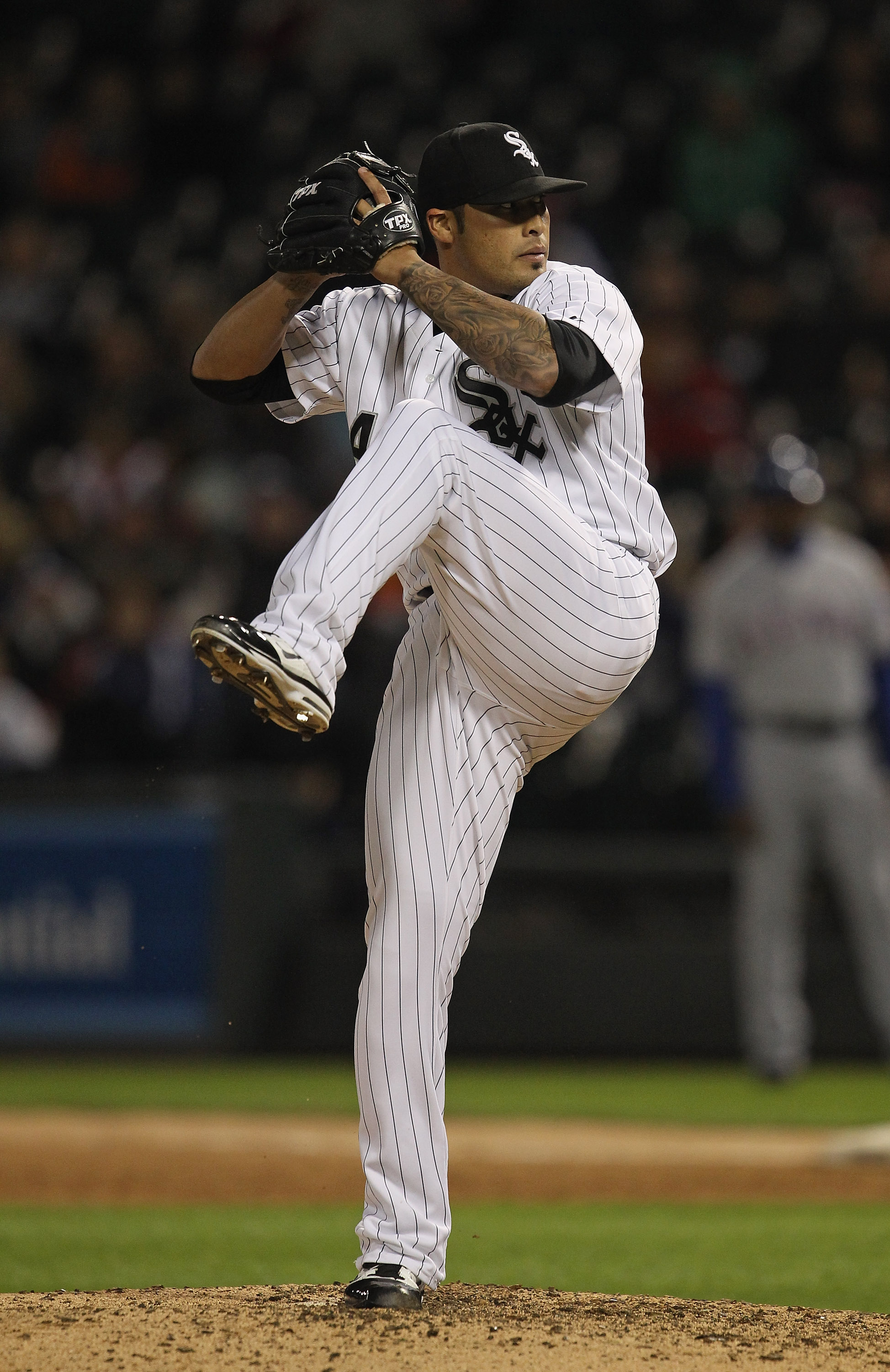 CHICAGO, IL - MAY 17: Sergio Santos #46 of the Chicago White Sox pitches against the Texas Rangers at U.S. Cellular Field on May 17, 2011 in Chicago, Illinois. The White Sox defeated the Rangers 4-3. (Photo by Jonathan Daniel/Getty Images)