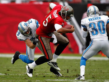 TAMPA, FL - DECEMBER 19:  Safety John Wendling #29 of the Detroit Lions tackles quarterback Josh Freeman #5 of the Tampa Bay Buccaneers during the game at Raymond James Stadium on December 19, 2010 in Tampa, Florida.  (Photo by J. Meric/Getty Images)