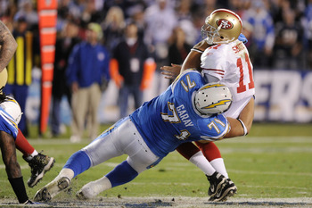 SAN DIEGO, CA - DECEMBER 16:  Quarterback Alex Smith #11 of the San Francisco 49ers is sacked by defensive tackle Antonio Garay #71 of the San Diego Chargers in the second quarter at Qualcomm Stadium on December 16, 2010 in San Diego, California.  (Photo
