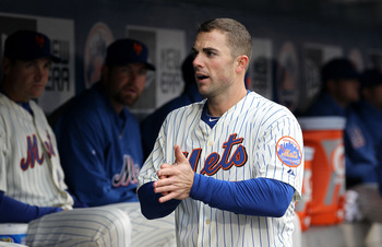 NEW YORK, NY - APRIL 08:  David Wright #5 of the New York Mets looks on from the dugout against the Washington Nationals during the Mets' Home Opener at Citi Field on April 8, 2011 in the Flushing neighborhood of Queens in New York City.  (Photo by Al Bel