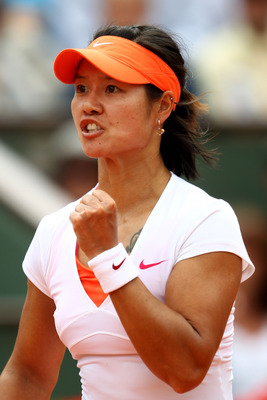 PARIS, FRANCE - MAY 30:  Na Li of China celebrates a point during the women's singles round four match between Na Li of China and Petra Kvitova of Czech Republic on day nine of the French Open at Roland Garros on May 30, 2011 in Paris, France.  (Photo by