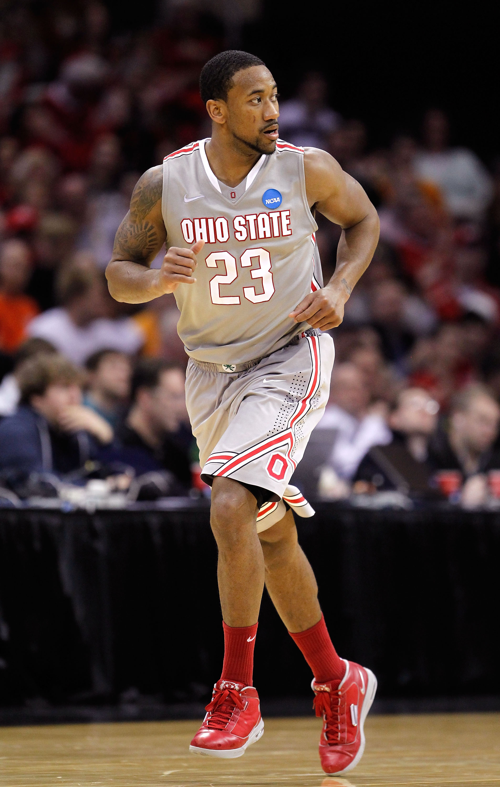 CLEVELAND, OH - MARCH 20: David Lighty #23 of the Ohio State Buckeyes runs up court after a play against the George Mason Patriots during the third of the 2011 NCAA men's basketball tournament at Quicken Loans Arena on March 20, 2011 in Cleveland, Ohio.