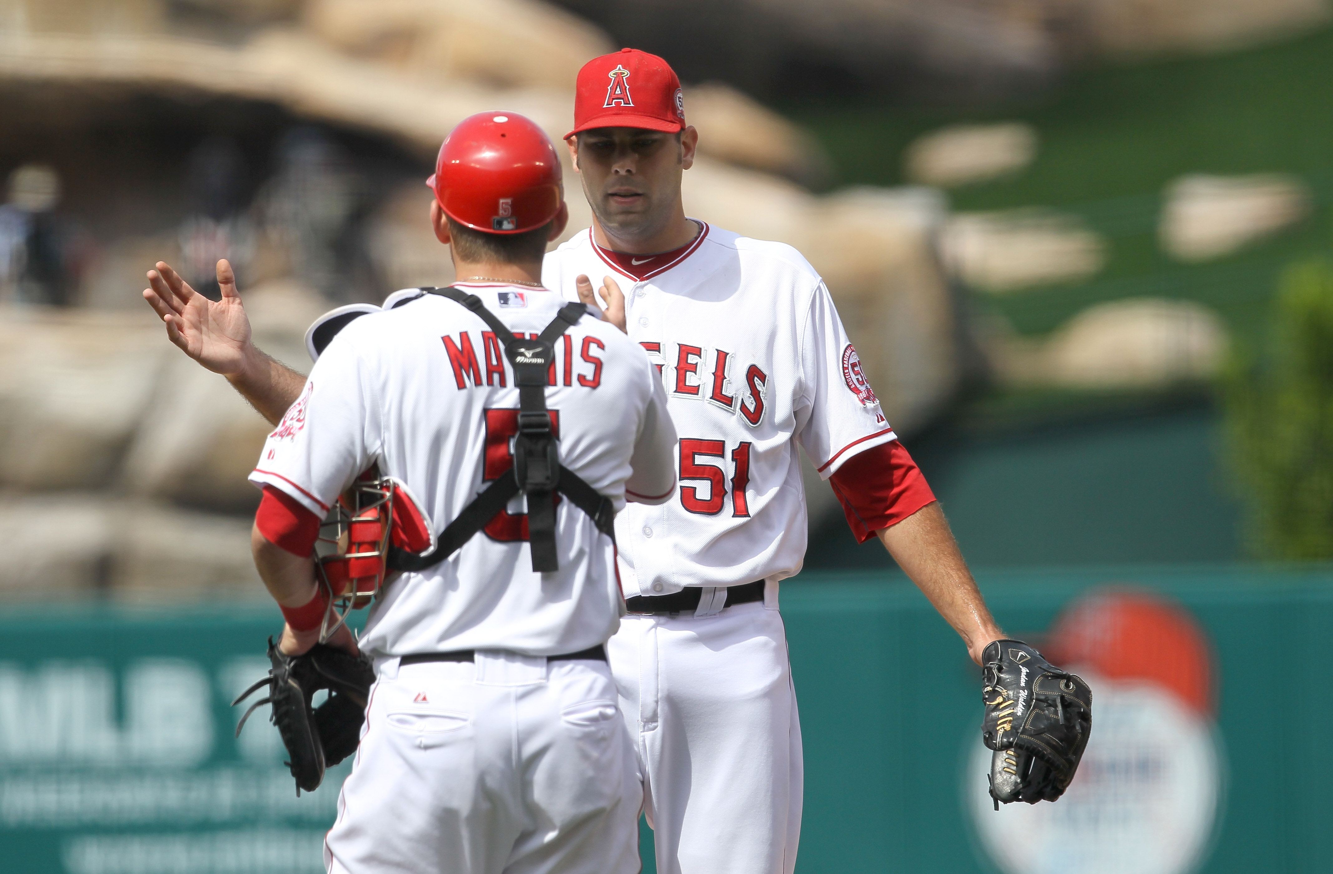 ANAHEIM, CA - MAY 22:   Relief pitcher Jordan Walden and catcher Jeff Mathis #5 of the Los Angeles Angels of Anaheim celebrate after getting the final out against the Atlanta Braves on May 22, 2011 at Angel Stadium in Anaheim, California.   The Angels won