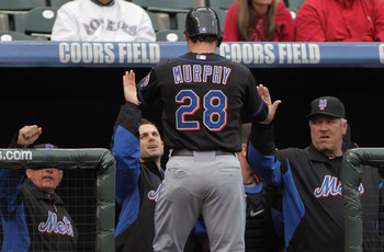 DENVER, CO - MAY 12:  Daniel Murphy #28 of the New York Mets is welcomed back to the dugout after scoring on a two RBI single by Jose Reyes #7 of the Mets to give the Mets a 5-1 lead over the Colorado Rockies in the fourth inning at Coors Field on May 12,