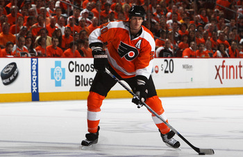 PHILADELPHIA, PA - APRIL 26:  Chris Pronger #20 of the Philadelphia Flyers controls the puck against the Buffalo Sabres in Game Seven of the Eastern Conference Quarterfinals during the 2011 NHL Stanley Cup Playoffs at Wells Fargo Center on April 26, 2011